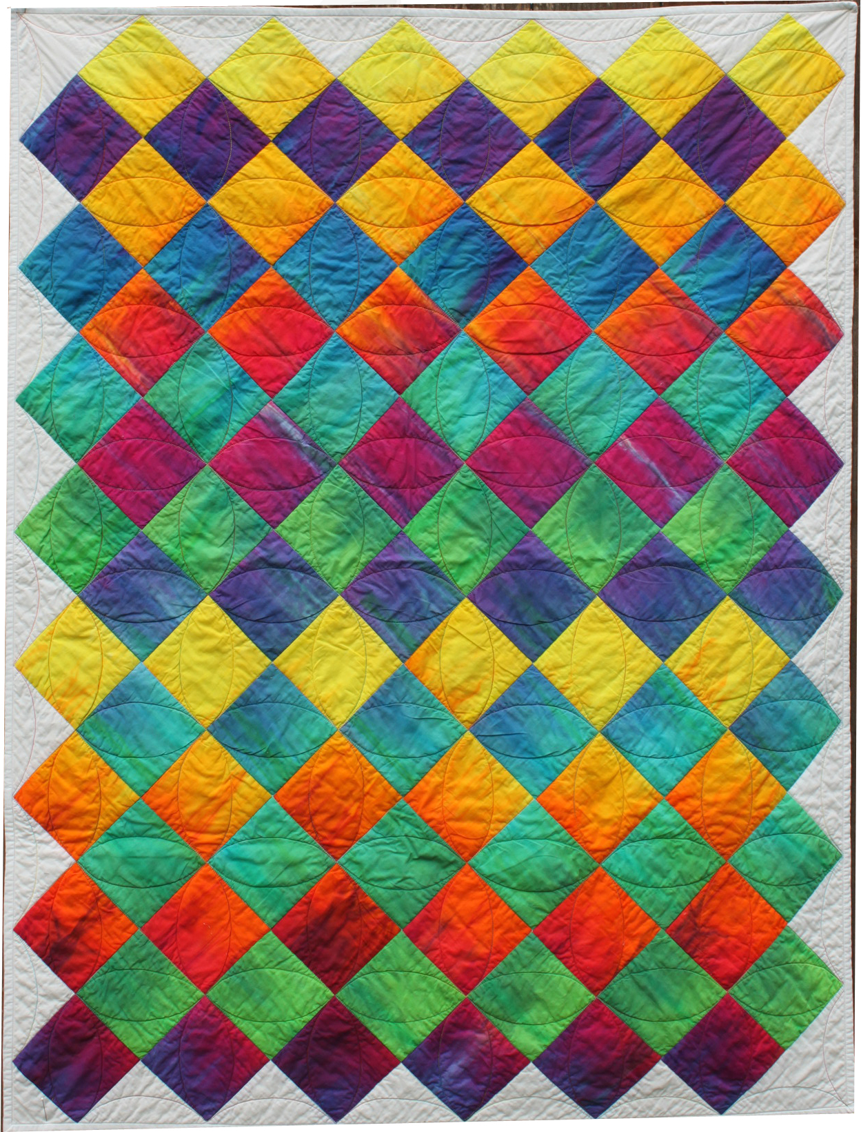 Learn how to make and quilt this easy Rainbow crib quilt.
